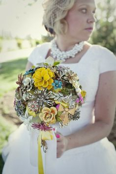 """Check out this beautiful Heirloom Brooch Bouquet made by """"top this wedding"""" Debbie. That's my niece, Roni at her wedding"""