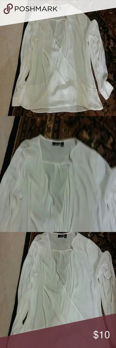 White shirt Beautiful white blouse can dress up or down..low cut in the front so would wear a tank or sexy bra underneath Tops Blouses