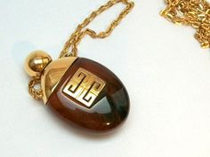 1975 Bakelite Givenchy Perfume Bottle Necklace by thedepo on Etsy,