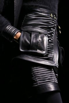Layered skirt with pleated panelling & leather trim with topstitching; closeup fashion details // Balmain