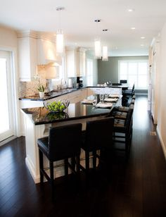 Angled kitchen island with seating on 1 side