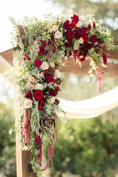 Outdoor Ceremony Decorated Wooden Arch Fresh Florals Red Cream Pink Roses Amaranth Greenery Luxe Outdoor Garden Wedding in California http://figlewiczphotography.com/