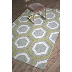 This modern easy care Radiance sea glass rug makes a splash in indoor and outdoor settings alike. Hooked in polypropylene, the multi-textured rug is both playful and practical and it only takes a quick rinse with a garden hose to refresh its beauty.