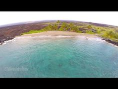 Aerial Drone Fly Over Pohue Bay, Hawaii. Flying my dji quadcopter drone at an amazing beach, hawaii, big island, gopro, phantom 2, palm trees, turtle research, no access, off the beaten path, turquoise, crystal clear water, reef.  Follow me at: Facebook: https://www.facebook.com/davidsknr Instagram: http://instagram.com/davidsknr Google+: https://plus.google.com/u/0/+DavidSkinner80/posts
