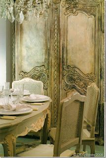 love the center trim on French armoire and the beautiful detail of the table's legs and table apron
