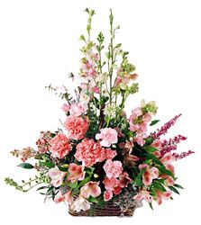 "An array of pink blooms artfully arranged is a celebration of life and a special memory.<br><br>Approximately 24""H x 22""W"
