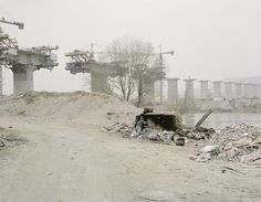 Zhang Kechun Workers Taking Midday Rest beside a Bridge, Gansu, 2010