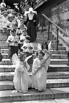 Henri Cartier-Bresson - Paris. 8th arrondissement. The Corpus Christi procession at the Madeleine church. 1951.