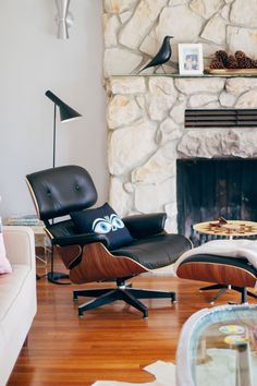 Some new modern design classic additions: Arne Jacobsen AJ Lamp by Louis Poulsen. Alexander Girard Eye pillow, Vitra Eames House bird. I'm in love with be with the AJ lamp. Herman Miller Eames Lounge ELO 670