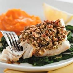 Almond-&-Lemon-Crusted Fish with Spinach  Per serving: 243 calories; 12 g fat (1 g sat, 8 g mono); 67 mg cholesterol; 8 g carbohydrates; 27 g protein; 4 g fiber; 508 mg sodium; 849 mg potassium.