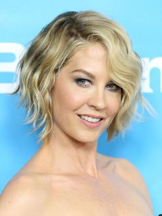 Letting face-framing layers grow in while keeping the back of hair neatly trimmed smooths the transition from a shorter style to a chic, A-line cut.