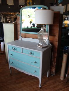 A sweet little dresser with a mirror in teal and Paris gray chalk paint.