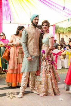 Looking for powder blue lehenga blouse with peach lehenga? Browse of latest bridal photos, lehenga & jewelry designs, decor ideas, etc. Indian Groom Wear, Indian Bridal Wear, Indian Attire, Indian Wear, Indian Dresses, Indian Outfits, Ethnic Outfits, Sangeet Outfit, Bollywood
