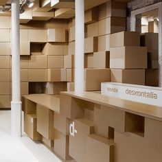 Deskontalia store in Donostia  by VAUMM  Internetshoppers in San Sebastian can now pick up their purchases from a shop that appears to be furnished with nothing but cardboard boxes (+ slideshow).
