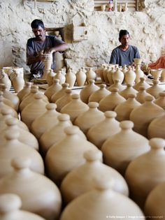 Men making pottery at Aali, Bahrain, United Arab Emirates, Middle East