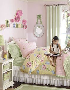 Beautiful green and pink girls bedroom idea that will grow with your child. Discover more kids room decorating and organizing tips and ideas @ http://kidsroomdecorating.net