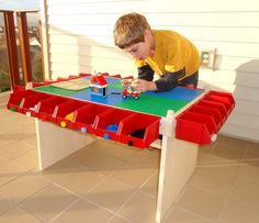 Lego table--I wonder if the little plastic holders from ikea will sit on the edge of the train table....