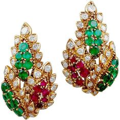 """Van Cleef & Arpels """"Maharajah"""" collection multicolor earclips.  France.  1955.  Elegant pair of Indian style leaves earrings set with gem emeralds, rubies and diamond within a gold rope design. Perfect Van Cleef & Arpels period earrings. Listing via 1stdibs."""