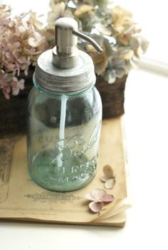 Do you have an old mason jar you'd like to put to good use? Why not transform it into your favorite mason jar soap dispenser? Mason Jar Soap Pump, Quart Mason Jars, Mason Jar Soap Dispenser, Blue Mason Jars, Soap Dispensers, Canning Jars, Ball Jars, Repurposed Items, Vintage Tablecloths