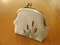 https://flic.kr/p/i7VJjB | cattail snap frame purse | pouch with original hand embroidered cattail motif on linen.   part of the { y * handmade } collection