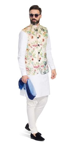 This Nehru Vest is inspired by the rich floral diversity of Portuguese royalty on a silk base. It has been carefully crafted with patch pockets and horn buttons. Style this piece with a light-coloured Kurta or shirt to enhance its appeal. Indian Formal Wear, Mens Indian Wear, Mens Ethnic Wear, Indian Groom Wear, Indian Men Fashion, Mens Fashion Suits, Mens Suits, Groom Fashion, Men's Fashion