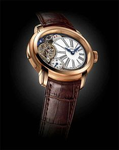 The Audemars Piguet Millenary Minute Repeater in rose gold comes on a hand-sewn brown crocodile strap with a folding clasp, also in 18k rose gold. The movement's winding system includes a security device that prevents time-setting operations while the repeater is chiming, which reduces the risk of damage.