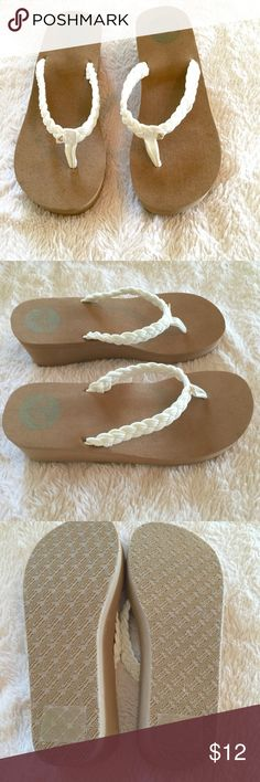 Roxy Cream Braided Flip Flops Roxy cream braid flip flop is a low wedge, dark brown sole and made of Nylon. Comfortable and beautiful on! Tried on to big they are true to size. Roxy Shoes Sandals