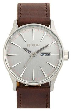 Free shipping and returns on Nixon 'The Sentry' Leather Strap Watch, 42mm at Nordstrom.com. Elongated indexes give a sleek look to a modern round watch detailed with a retro day-and-date window and paired with a leather strap.