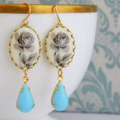Vintage West German Grey Rose Cameo Pale Blue Teardrop Earrings. $24.50, via Etsy.