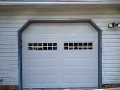 Gorgeous long panel door with stockton windows on the 3rd panel. Draws the eye - increases curb appeal