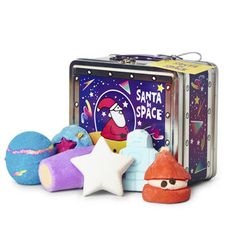Santa In Space Reusable Tin Gift: Santa's been zipping around the cosmos with a lil' robot buddy at his side, and you can follow their journey through the splendor of space with this collection of astrologically themed treats for the bath.