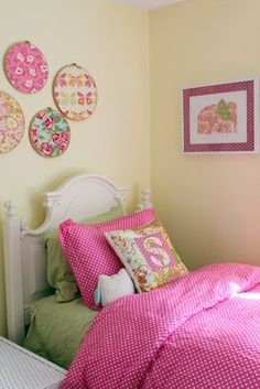 Girl's bedroom - love the fabric in embroidery hoops...