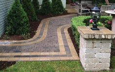 The pattern that's been created with the paving stones of this walkway has a thoroughly luxurious style.