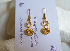 Gold Love Knot Earrings by VintagePlusCrafts on Etsy, $10.00