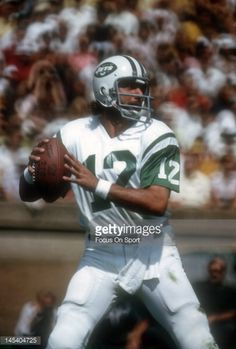 Quarterback Joe Namath of the New York Jets drops back to pass during an NFL football game circa Namath played for the Jets from New York Jets Football, Nfl Football Games, Nfl Football Players, Nfl Jets, Football Moms, Titans Football, Redskins Football, Broncos, American Athletes