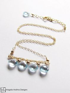 The Something Blue Necklace: Horizontal Hammered Gold And Blue Topaz Drops