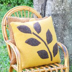 Upcycled Pillows from Felted Sweaters | Turn an old sweater into a chic spring pillow with this easy applique project!
