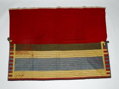 Cloak [match coat] of red wool decorated with coloured silk ribbon and white beads: Canadian Indians, Algonkin, from the Great Lakes, possibly Ottawa, late 18th century Museum reference A.1982.302