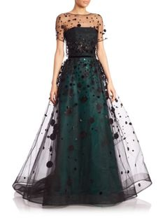 Carolina Herrera Gown with a Black Velvet Polka Dot Tulle Overskirt and Removable Tulle Shrug, a Black Satin Strapless Bodice and an Emerald Green Underskirt. This is a complex and versatile Gown for your Most Important Occasions. I've picked up the Emerald Underskirt with (what else?) actual Emeralds, Big and Glowing - Yea! Now add Embellished Black Satin Pumps and a Black Satin Clutch (It's all on this board). This is an Elegant Look. Stand Tall and Wear it - Gabrielle
