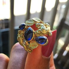 Enjoying the long summer days with our 18k Yellow Gold and Sapphire Treefrog Ring #showmeyourrings #sapphire #frogs #goldisbest #18k #luxurywithaface