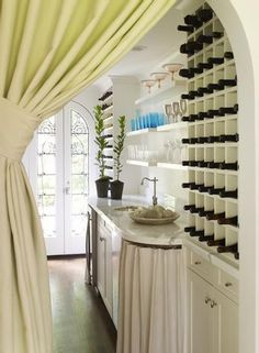 Lovely Butler's Pantry with portiere, partially-skirted sink console, and French doors