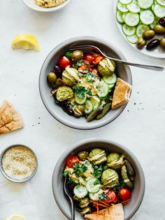 Quick and easy falafel bowls loaded with flavorful vegetables, (homemade) baked falafel, sprouted hummus, and tahini sauce.