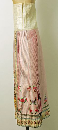 "19th century Chinese Women's ""five-terrace sleeve"" robe and pleated skirt// Medium: silk, metal // Dimensions: (a) Length: 40 1/4 in. (102.2 cm) (b) Length: 39 in. (99.1 cm) // Credit Line: Gift of Mr. Beaumont Newhall, 1943 // Accession Number: C.I.43.12.84a–c"