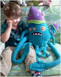 plush sea monster with parasitic twin by Daniel Allyn Lee. Sadly, it seems he has stopped making plush monsters.