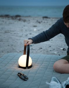 The LED Carrie light from Norm Architects in Denmark. This USB rechargeable lamp was design to provide a simple, elegant way to have light wherever you go. Lamp Design, Lighting Design, Modern Lighting, Lighting Ideas, Outdoor Lighting, Hygge, Design Minimalista, Carrie, Lantern Designs