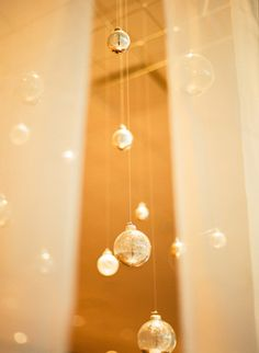 clear ornaments dipped in gold, hung by fishing line in trees? yes please!