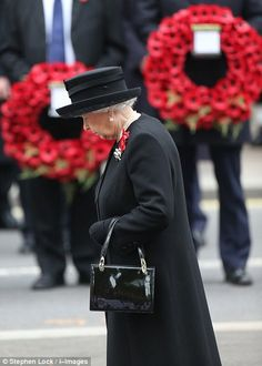The Queen has led Britain in a silent mark of respect to honour the nation's war dead in a Remembrance Sunday service at the Cenotaph in central London this morning