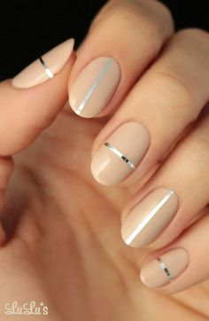 edgy yet simple graphic nails nude with metallic stripes!