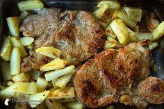 Braciole di maiale con patate al forno