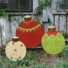 Handcrafted of metal and joyously painted in the season's colors, these slightly distressed ornaments for the yard come as a set of three, $118.00